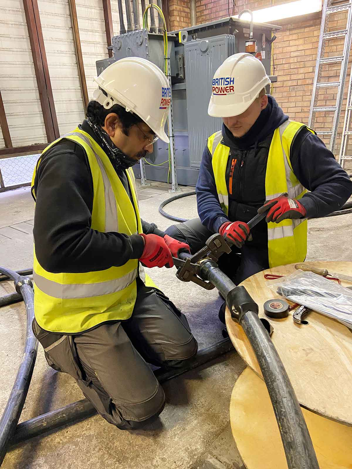 2 Fitters Preparing Cable on the floor